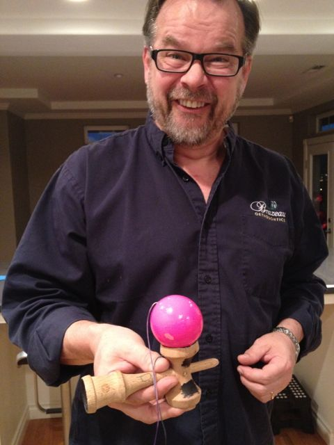 Joe with Elizabeth's kendama, a fad that took off on the West Coast while I was gone and which doesn't involve cell phones, boy bands or ultraviolence. I just don't get you crazy kids these days.