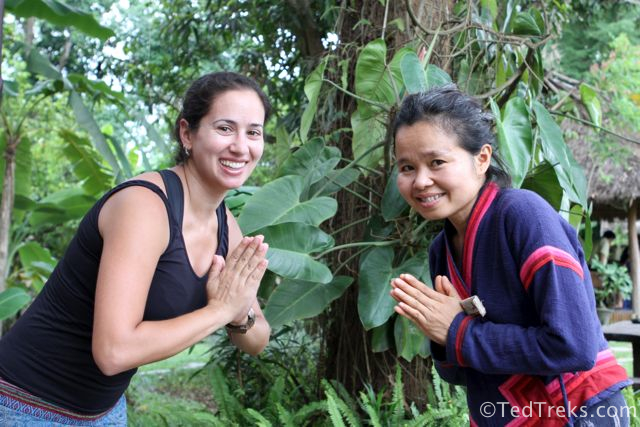 "Lauren, a friend from the guesthouse, performing a traditional greeting, the ""nop"", with Jen."