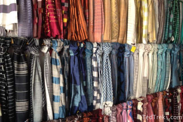 A wall of hand-woven scarves at the shop in Luang Prabang